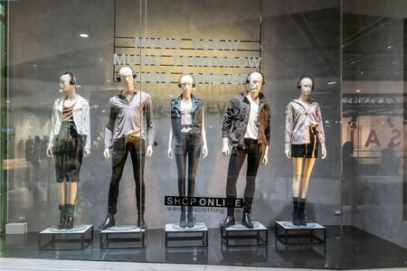 CPS shop at Siam Paragon, Bangkok, Thailand, July 7, 2019 : Fashionable brand window display. Standing models in different styles of colorful clothings. Editöryel
