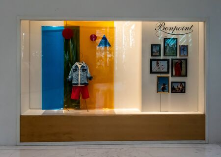 Kids 21 shop at Emquartier Thailand, July 7, 2019 : Luxury and fashionable brand window display. Casual Kid clothings with colorful background in front of the store. Redakční