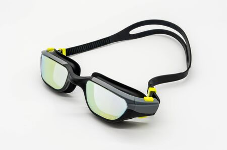 High quality fashion mercury coated swimming goggle in black, grey and green isolated on white.