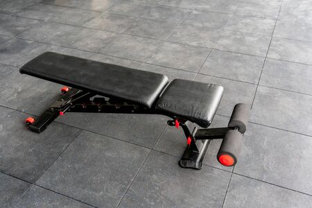 Black and red reinforced flat inclined weights bench.