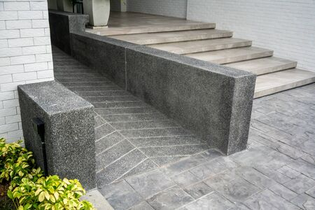 Ramped access, using wheelchair ramp for disabled people. Concrete ramp pathway. Reklamní fotografie