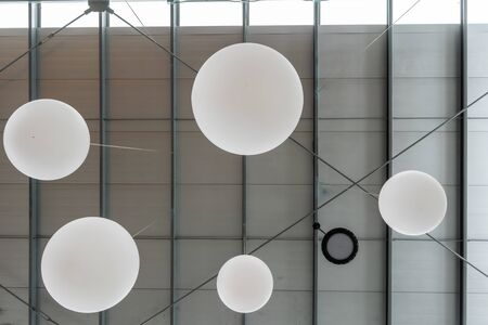White sphere lamps hanging from ceiling for decoration. Stok Fotoğraf