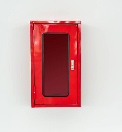 Empty red metal box hanging on white