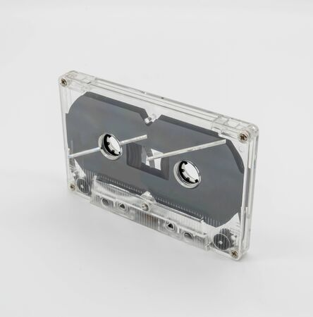 Vintage clear plastic cassette tape isolated on white