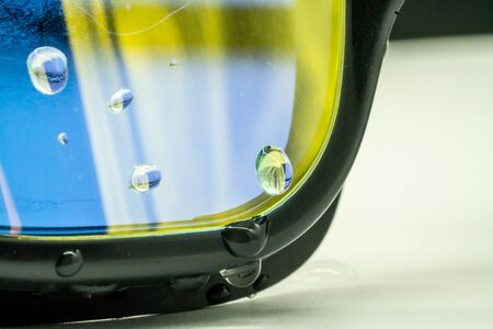 Close-up on drops of water on high quality fashion mercury coated swimming goggle