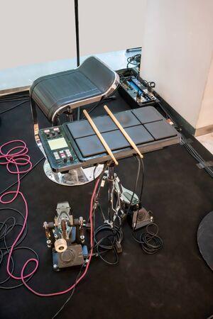 Electric drum digital drum music instrument. Drum sticks on a Electric drum background.