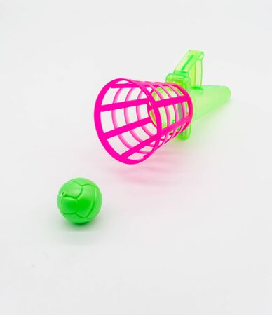 Pink and green hand basketball toy isolated on white background