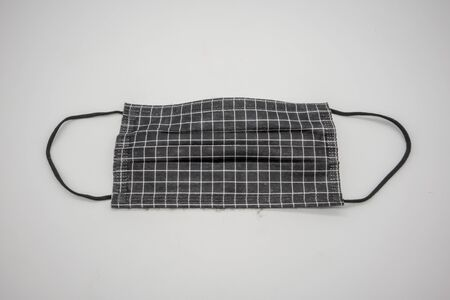 Disposable anti pollutant face mask in black color with comfort strap isolated on white background.