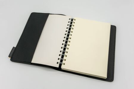 Black leather pocket notebook or sketchbook isolated on white background. Stock Photo