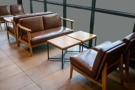 Living area in coffee shop or restaurant. Close up Comfort Chair with Wooden Table in restaurant.