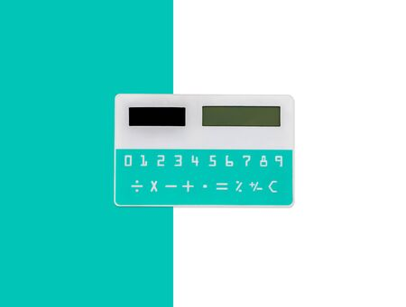 Pocket mini calculator in white and green colors isolated on white background. Path selection included.
