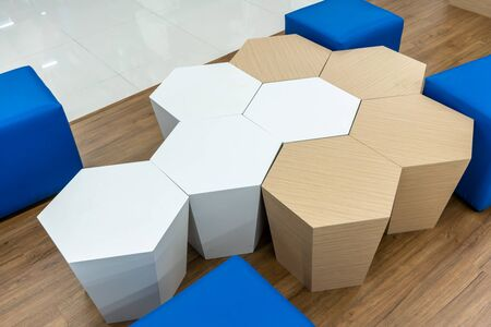 Hexagon shape chairs on wooden floor in rest area. Interior design detail. 版權商用圖片