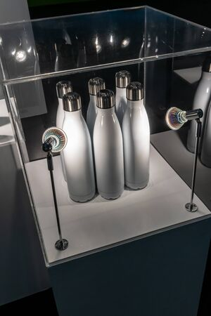 Silver and White Empty Glossy Metal Reusable Water Bottle with Silver Bung Set in display.