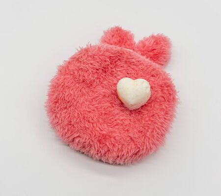 Cute Mini heart bath bomb on red fluffy carpet like isolated on white background for valentines vibe. 版權商用圖片