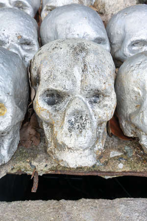 Rusty artificial skull sculptures for cremation, decoration or background.