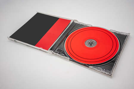 Black and red compact disc, CD, with plastic case isolated on white background. Template