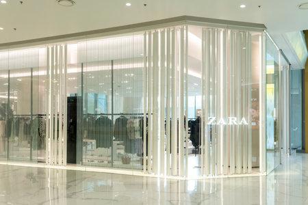 Zara shop at Saim Paragon Bangkok, Thailand, Nov 28, 2020 : Zara window display. Luxury and fashionable clothing and bag shop in white decoration. Interior design detail.