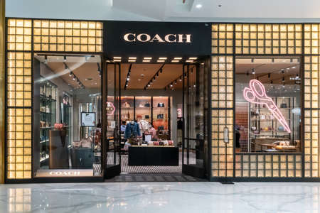 Coach shop at Icon Siam, Bangkok, Thailand, Nov 28, 2020 : Luxury and fashionable brand visual merchandised idea. New collection of fashion bags display. Sajtókép