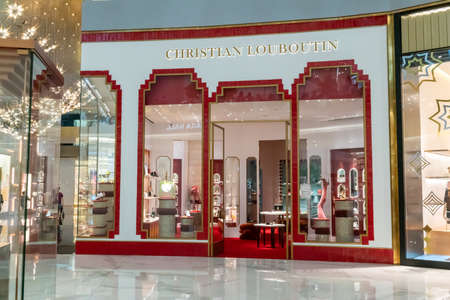 Christian Loboutine shop display at Icon Siam, Bangkok, Thailand, Nov 28, 2020 : Luxury fashionable clothing and shoes visual merchandising and window shopping in Christmas season greeting.