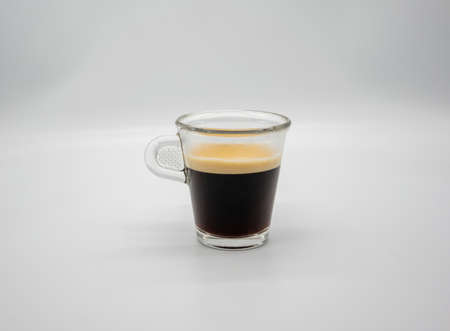 Close up of a glass of espresso isolated on white background Stock fotó