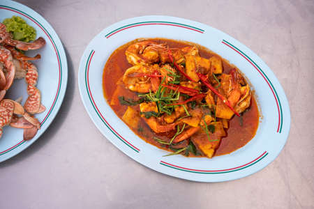 THAI SHRIMPS RED CURRY. Thailand tradition red curry soup with shrimps prawns and coconut milk. Stock fotó