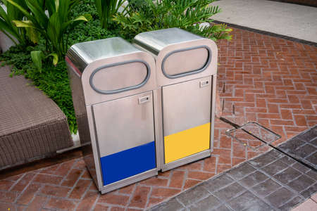 Stainless steel general and recycle waste bins in public space. Stainless modern trash can Stock fotó