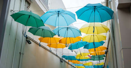 Street decorated with colored umbrellas. Perspective view of Umbrella Street.