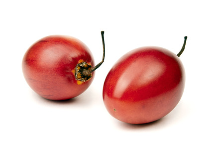 tamarillo: Two whole ripe and juicy tamarillo on white background Stock Photo