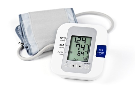 Digital Blood Pressure Monitor on white background Stock Photo