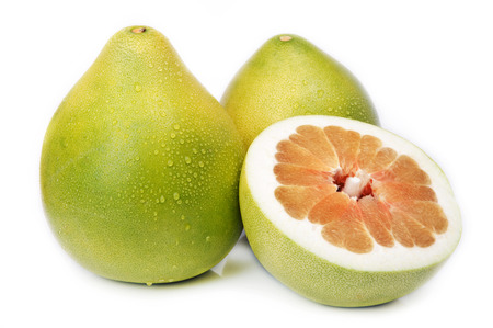 pummelo: Two  whole and a half of pummelo fruit