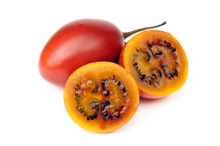 tamarillo: Tamarillo, whole and cut half-and-half on white