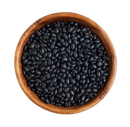 Top view of wooden bowl full of black beans Standard-Bild