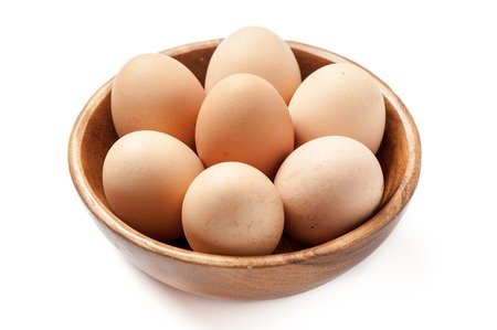 Eggs in wooden bowl Standard-Bild