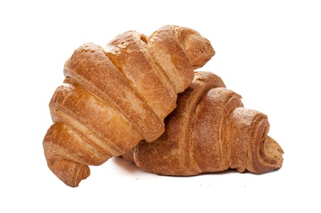 Just baked appetizing croissants on white background