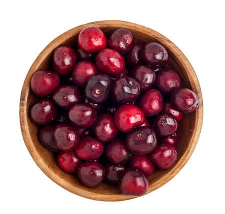 Wooden bowl full of cherries
