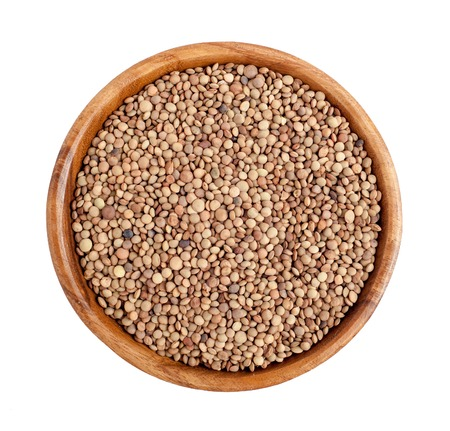 Top view of wooden bowl full of lentils