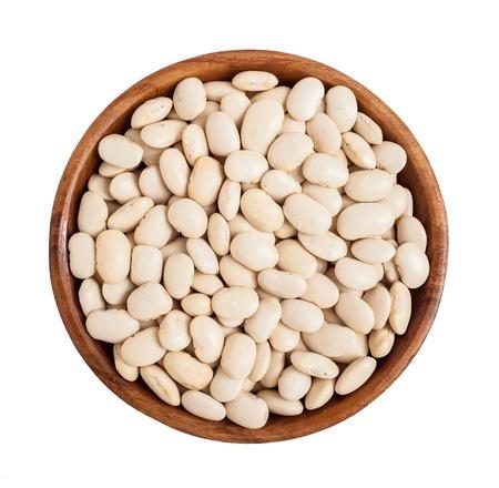 Wooden bowl full of lima beans Standard-Bild