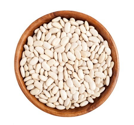 Top view of wooden bowl full of white beans