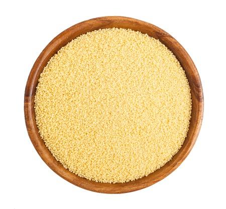 Wooden bowl full of millet
