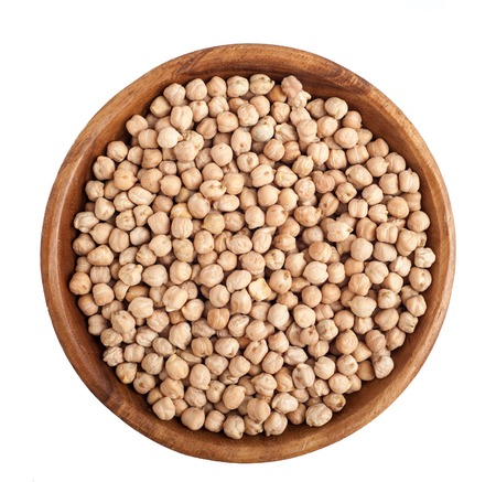 Top view of wooden bowl full of chickpeas