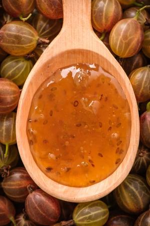 Wooden spoon with gooseberries jam