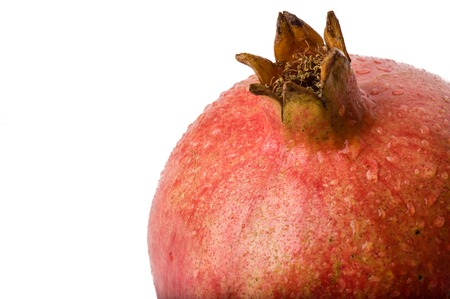 Closeup of Pomegranate on white background