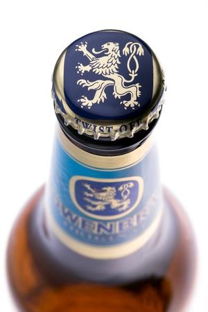 dewed: Germany Beer. Top view of Lowenbrau beer bottle on white backround