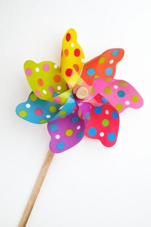 Colorful pinwheel toy on white background
