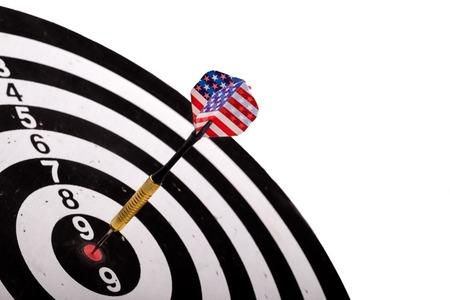 USA Flag Dart Stuck in a Bullseye Board with copy-space