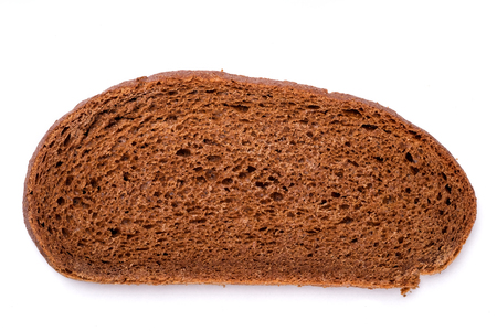 Top view of brown brread loaf on white background