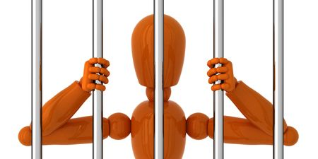 gaol: Orange mannequin to be behind bars. Stock Photo