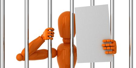 gaol: Orange mannequin to be behind bars with blank papper.