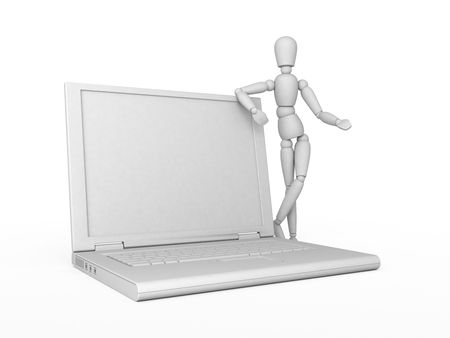 Gray mannequin and gray laptop. Isolated. photo