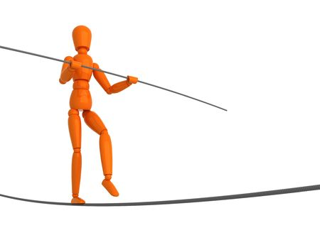 Orange mannequin is rope-walker. photo